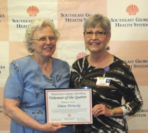 Diane Heinecke Receiving Volunteer of the Quarter
